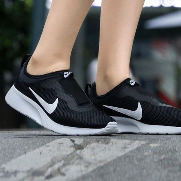 234d7c833f6e Nike Women s Tanjun Slip-On Black Size 9. M 5aabd617a44dbe8f37367afe